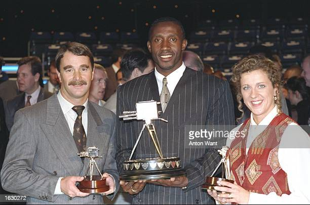 Portrait of Linford Christie with his Sports Personality of the Year award flanked by Nigel Mansell and Sally Gunnell with their trophies at the BBC...