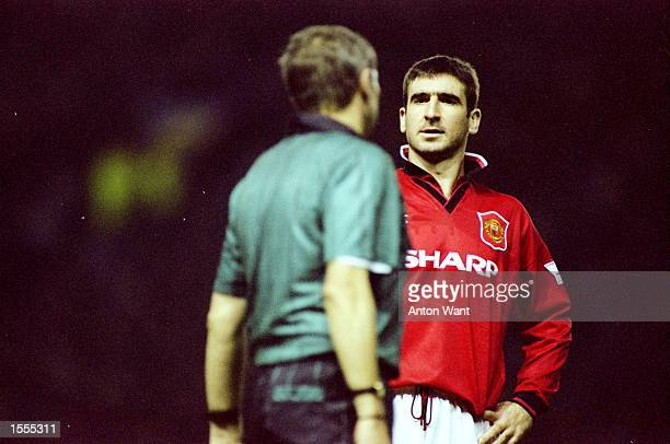 Eric Cantona of Manchester United talks to the referee during an FA Carling Premiership match against Nottingham Forest at Old Trafford in Manchester...
