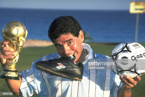 Portrait of Diego Maradona of Argentina with his World Cup trophy boot and ball in Cancun Mexico Mandatory Credit David Cannon/Allsport