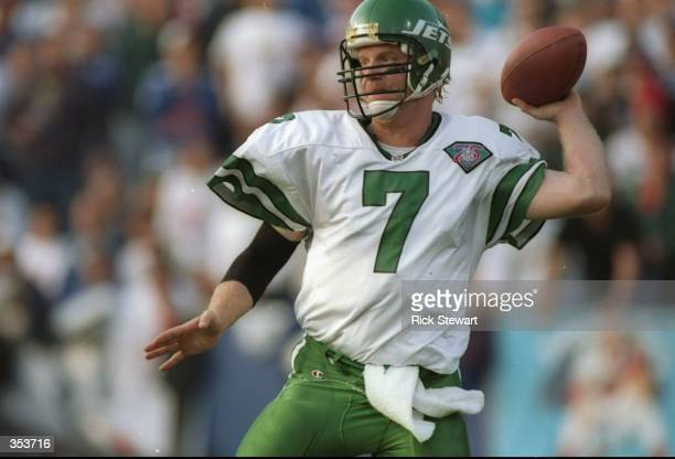 Quarterback Boomer Esiason of the New York Jets looks to pass the ball during a game against the New England Patriots at Foxboro Stadium in Foxboro...