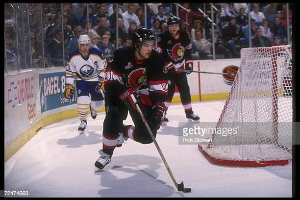 Center Alexandre Daigle of the Ottawa Senators moves the puck during a game against the Buffalo Sabres at Memorial Auditorium in Buffalo New York The...