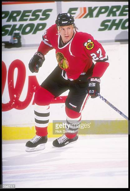Center Jeremy Roenick of the Chicago Blackhawks skates easy during a game with the Buffalo Sabres in the Memorial Auditorium in Buffalo New York The...