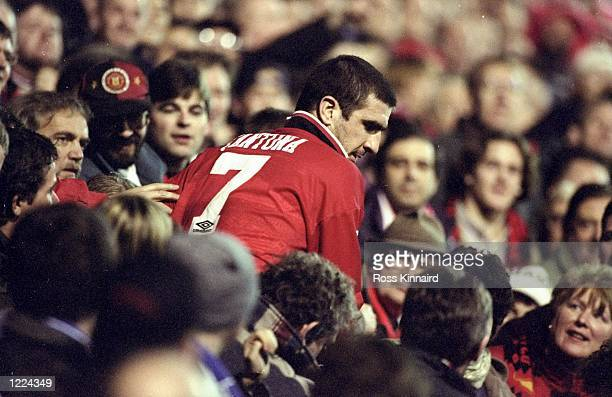 Eric Cantona of Manchester United is surrounded by the fans after an FA Carling Premiership match against Chelsea at Old Trafford in Manchester...