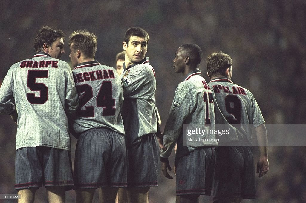 Eric Cantona looking back while forming a wall : News Photo
