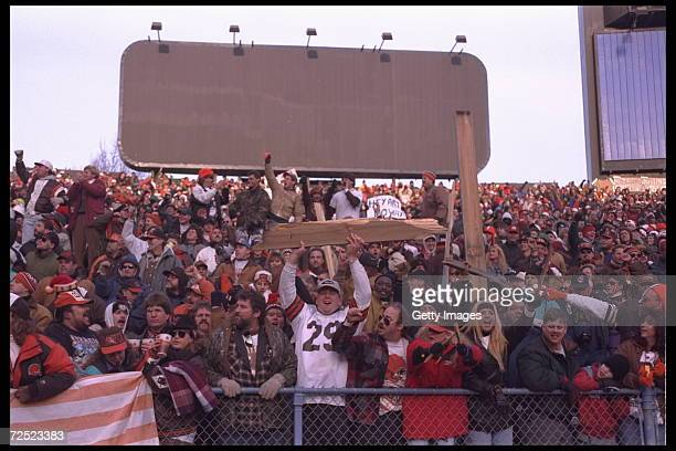 Fans of the Cleveland Browns in the 'Dog Pound' throw broken benches after the Browns final game at Cleveland Stadium in Cleveland Ohio before they...