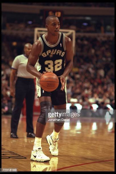 Forward Sean Elliott of the San Antonio Spurs moves the ball against the Chicago Bulls during a game played at the United Center in Chicago Illinois...