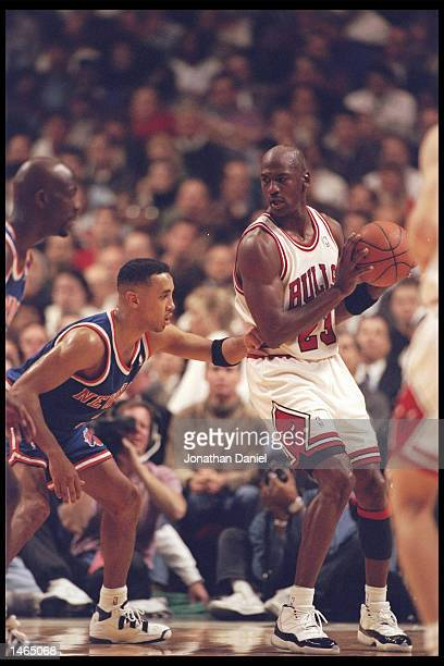 Guard John Starks of the New York Knicks tries to guard guard Michael Jordan of the Chicago Bulls at the United Center in Chicago, Illinois. The...