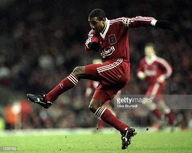 John Barnes of Liverpool takes a shot at goal during the FA Carling Premiership match against Arsenal played at Anfield in Liverpool England...
