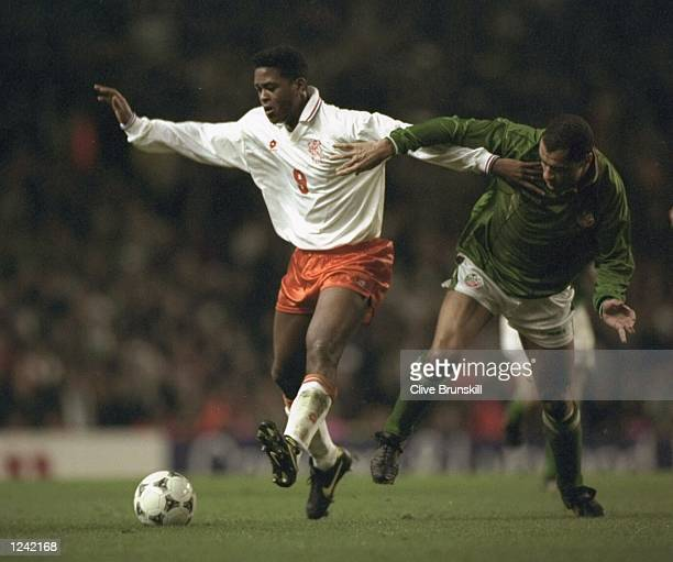 Patrick Kluivert of Holland is Tackled by Paul McGrath of Ireland during the European Championships play-off at Anfield. Holland went on to win the...