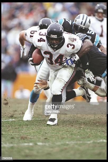 Running back Craig Heyward of the Atlanta Falcons moves the ball during a game against the Carolina Panthers at Clemson Memorial Stadium in Clemson,...