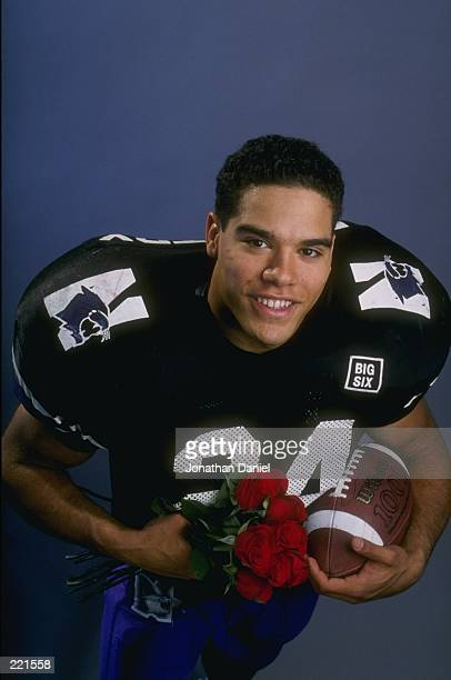 Running back Darnell Autry of the Northwestern Wildcats poses with a football and bouquet of roses in a studio setting for an upcoming matchup with...