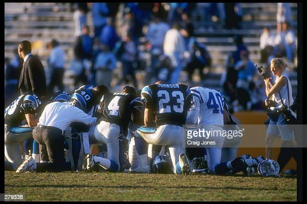 Several players join in prayer after a game between the Indianapolis Colts and the Carolina Panthers at Clemson Memorial Stadium in Clemson, South...