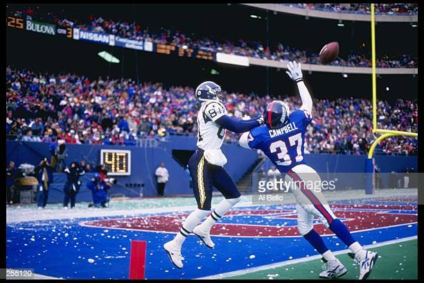 Wide receiver Tony Martin of the San Diego Chargers waits to catch the ball as cornerback Jesse Campbell of the New York Giants tries to bat it away...