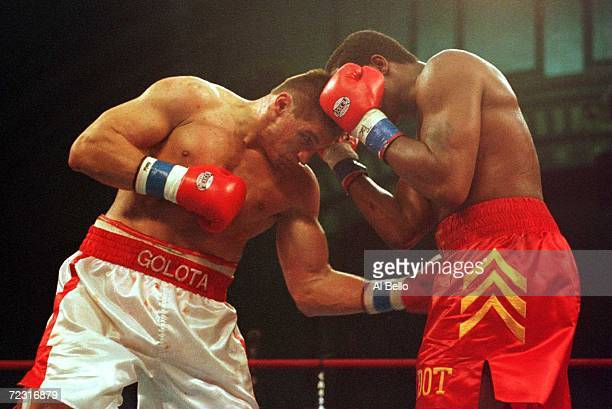 Andrew Golota delivers a low blow to Riddick Bowe during their return bout at the Atlantic City Convention Centre in Atlantic City New Jersey
