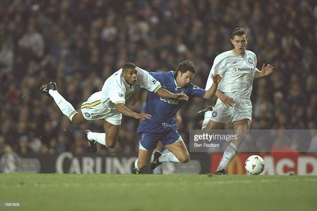 Carlton Palmer of Leeds is upended as he challenges Scott Minto of Chelsea, David Wetherall : News Photo