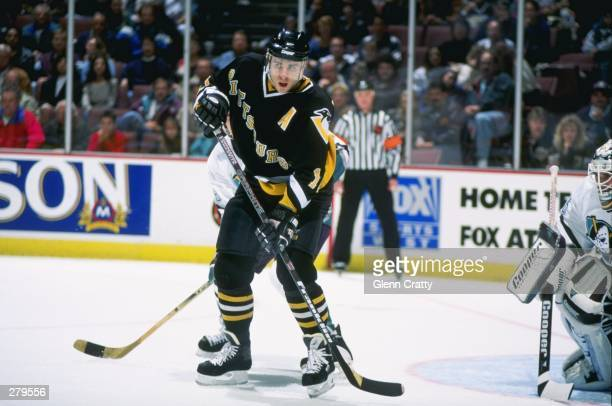 Center Ron Francis of the Pittsburgh Penguins moves down the ice during a game against the Anaheim Mighty Ducks at Arrowhead Pond in Anaheim,...