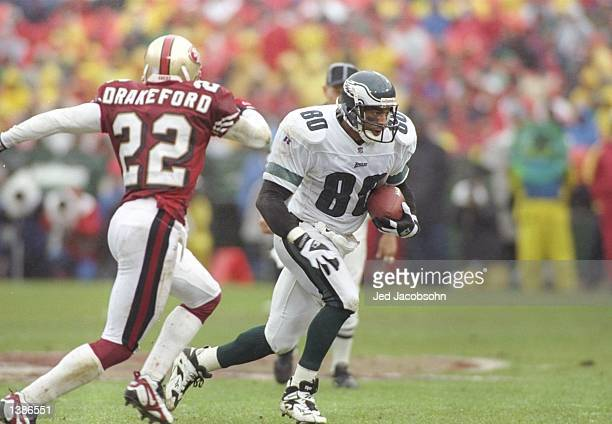 Cornerback Tyrone Drakeford of the San Francisco 49ers tries to cover wide receiver Irving Friar of the Philadelphia Eagles during a game at 3Com...