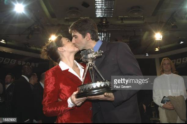 Damon Hill kisses wife Georgie after winning sport personality of the year during the BBC sports review in London Mandatory Credit Paul...