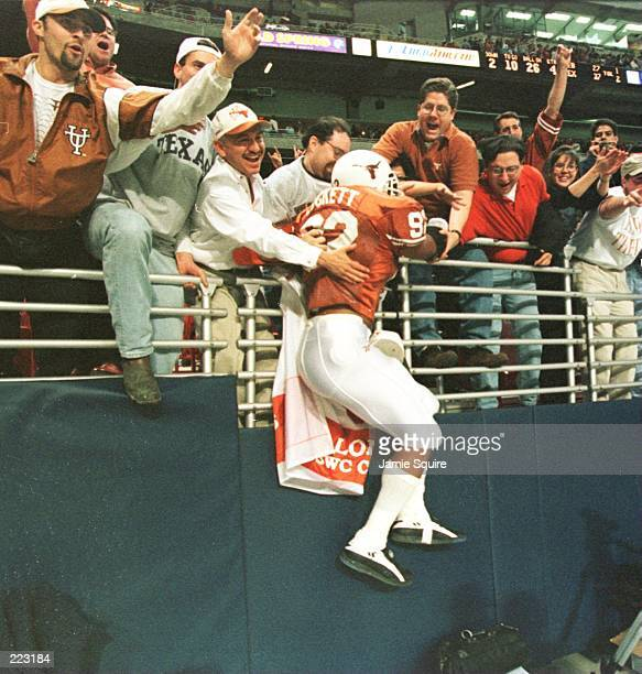Damon Luckett of the University of Texas jumps into the stands after the Longhorns 3727 win over the University of Nebraska in the inaugural Dr...