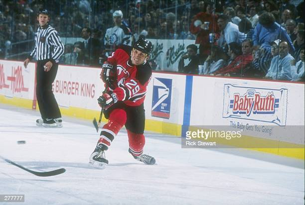 Defenseman Shawn Chambers of the New Jersey Devils moves down the ice during a game against the Buffalo Sabres at the Marine Midland Arena in...