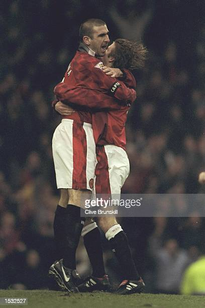 Eric Cantona and David Beckham of Manchester United celebrate after Cantona scored during the Premier League match against Leeds at Old Trafford...