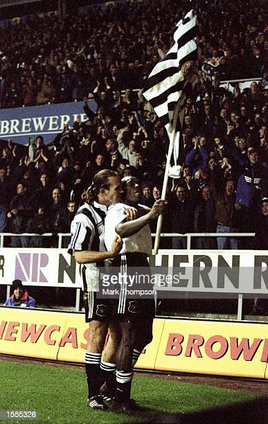 Faustino Asprilla of Newcastle United celebrates with team mate Darren Peacock after scoring during the UEFA Cup fourth round match against Metz at...