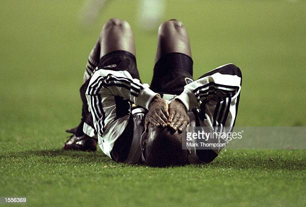 Faustino Asprilla of Newcastle United holds his hands over his face during the UEFA Cup Fourth Round match against Metz at St James'' Park in...