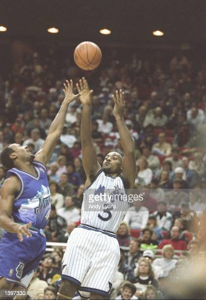 Forward Dennis Scott of the Orlando Magic shoots the ball during a game against the Utah Jazz at the Orlando Arena in Orlando Florida The Jazz won...