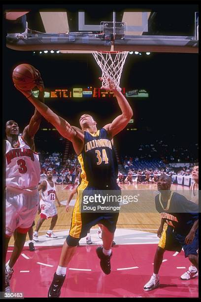 Forward LaRon Profit of the Maryland Terrapins and California Golden Bears forward Tony Gonzalez fight for the ball during a game at the USAir Arena...