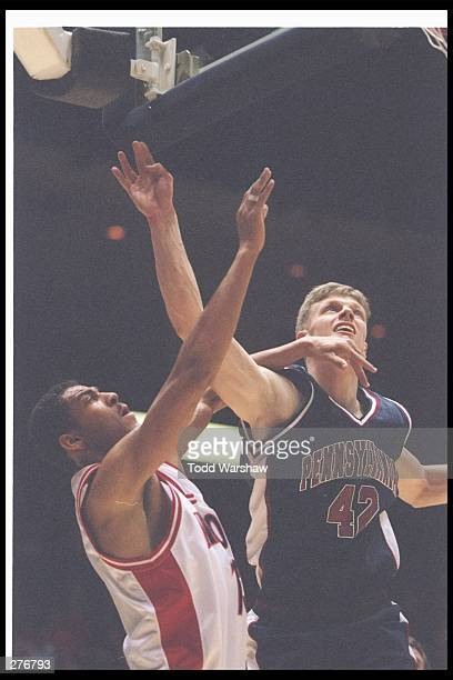 Forward Paul Romanczuk of the Pennsylvania Quakers competes at the net with forward Donnell Harris of the Arizona Wildcats during the Fiesta Bowl...