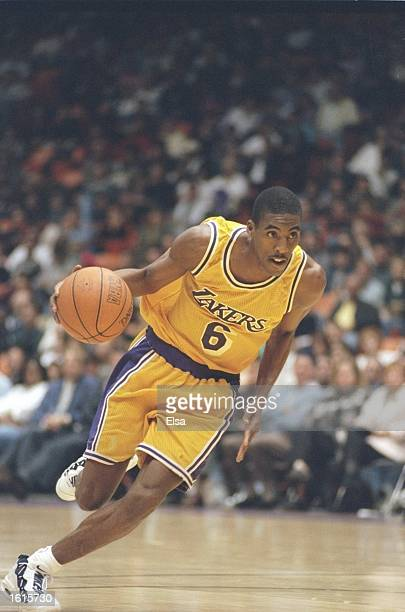 Guard Eddie Jones of the Los Angeles Lakers dribbles the ball down the court during a game against the Philadelphia 76ers at the Great Western Forum...