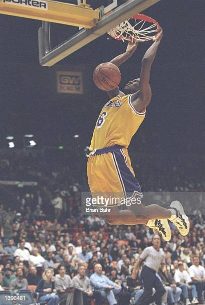 Guard Eddie Jones of the Los Angeles Lakers slam dunks the ball during a game against the Portland Trailblazers at the Great Western Forum in...