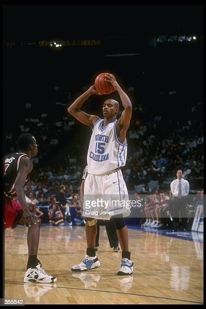 Guard Vince Carter of the North Carolina Tar Heels looks to pass the ball during the Pepsi Challenge against the South Carolina Gamecocks at the...