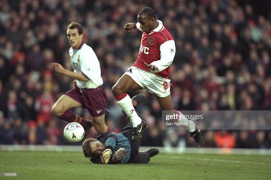 28 Dec 1996:  Ian Wright of Arsenal leaps over goalkeeper Mark Bosnich of Aston Villa during the Pre : News Photo