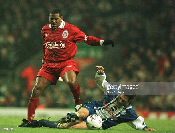 John Barnes of Liverpool is tackled during the Liverpool versus Sheffield Wednesday Premier League Match at Anfield in Liverpool, Great Britain....