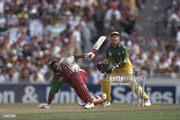 Junior Murray of the West Indies, at bat, loses his balance and is caught as Ian Healy looks on. During the one day international between Australia...