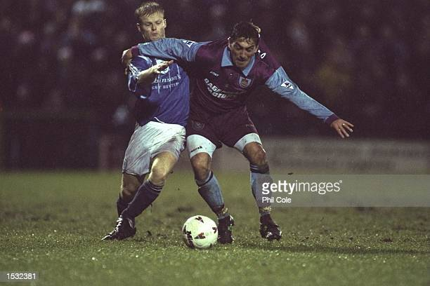 Kieran Durkan of Stockport is held off by Ilie Dumitrescu of West Ham during the Coca Cola cup tie between Stockport County and West Ham United at...