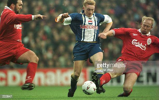 Peter Atherton of Shefields is tackled by Mark Wright and Neil Ruddock of Liverpool during theeir Wednesday Premier League Match at Anfield in...