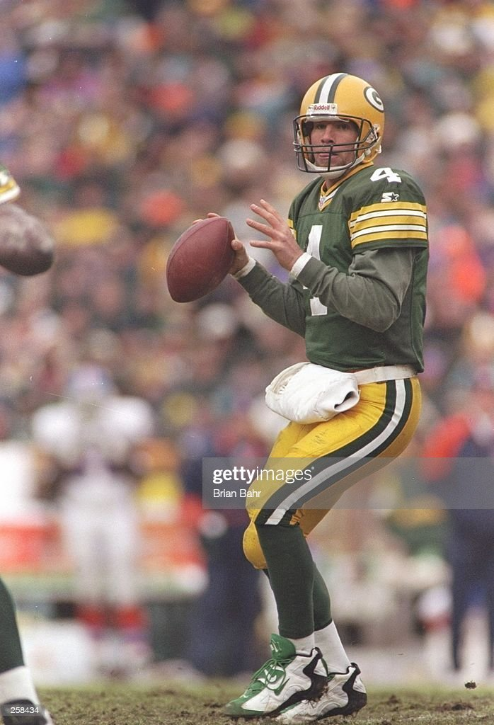 Quarterback Brett Favre of the Green Bay Packers drops back to pass during a game against the Denver Broncos at Lambeau Field in Green Bay, Wisconsin. The Packers won the game 41-6. Mandatory Credit: Brian Bahr /Allsport