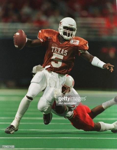 Quarterback James Brown of the University of Texas Longhorns is flushed from the pocket by Jamel Williams of the University of Nebraska Cornhuskers...