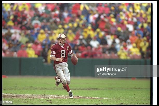 Quarterback Steve Young of the San Francisco 49ers moves the ball during a playoff game against the Philadelphia Eagles at 3Com Park in San Francisco...