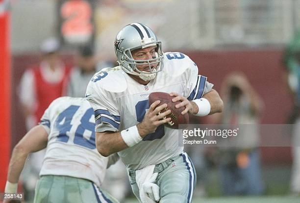 Quarterback Troy Aikman the Dallas Cowboys drops back to pass as fullback Daryl Johnston provides protection during a game against the Arizona...