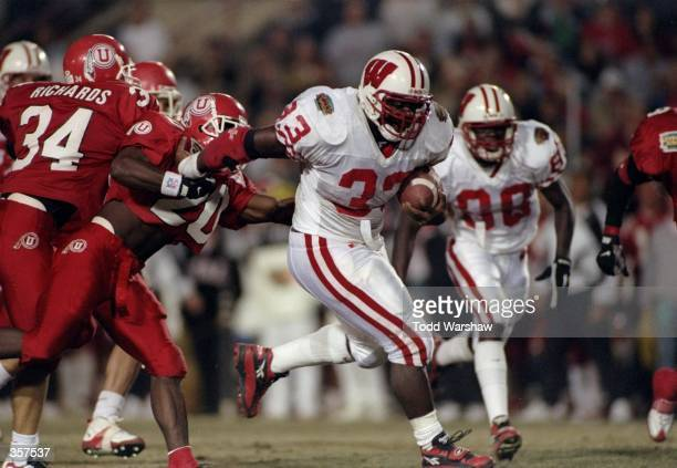 Ron Dayne of the Wisconsin Badgers moves the ball during the Copper Bowl against the Utah Utes at Arizona Stadium in Tucson Arizona Wisconsin won the...