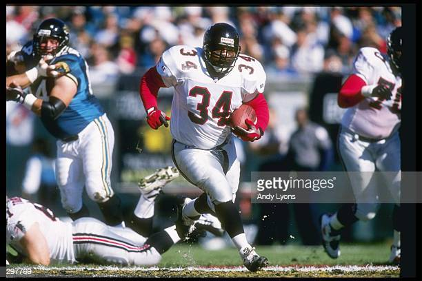 Running back Craig Heyward of the Atlanta Falcons moves the ball during a game against the Jacksonville Jaguars at the Jacksonville Municipal Stadium...