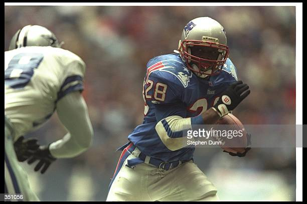 Running back Curtis Martin of the New England Patriots runs with the ball during a game against the Dallas Cowboys at Texas Stadium in Irving Texas...