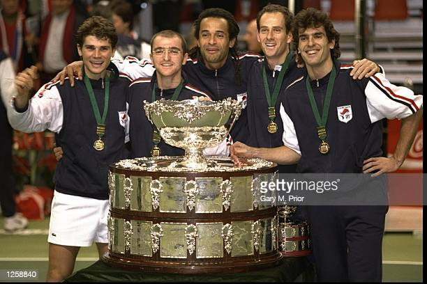 The French team with the Davis Cup Trophy after Arnaud Boetsch of France defeated Nicklas Kulti of Sweden in the Davis Cup Final in Malmo Sweden...