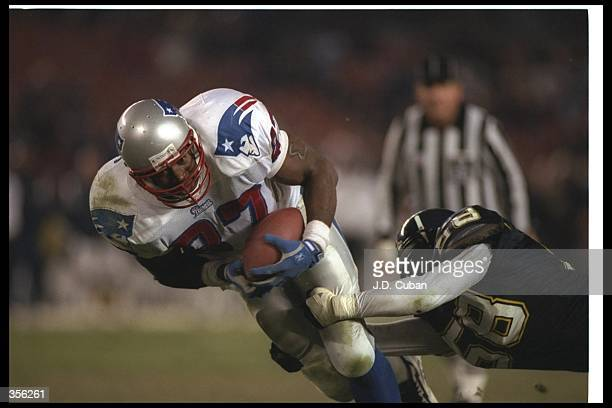 Tight end Ben Coates of the New England Patriots gets tackled by San Diego Chargers linebacker Lewis Bush during a game at Jack Murphy Stadium in San...