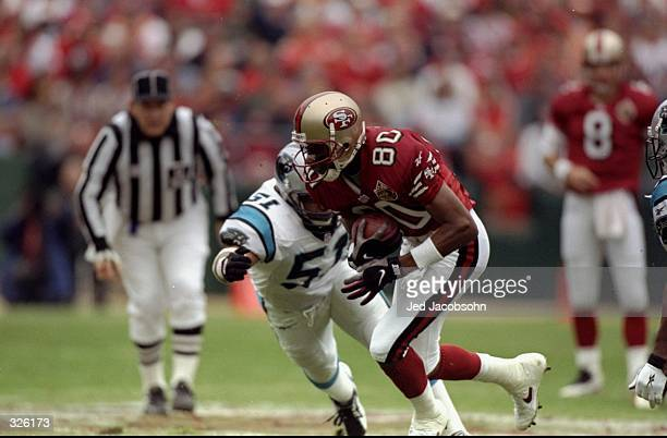 Wide receiver Jerry Rice of the San Francisco 49ers carries the football during the 49ers 3024 loss to the Carolina Panthers at 3 Com Park in San...