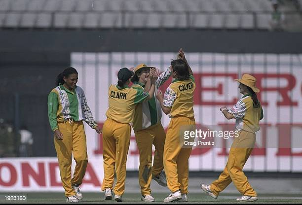 Australia celebrate a wicket during the Women's Cricket World Cup Final against New Zealand at Eden Gardens in Calcutta, India. Australia won the...