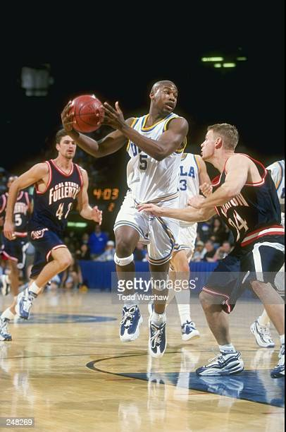 Baron Davis of the UCLA Bruins dribbles down the court during a game against the Cal State Fullerton Titans at the Pauley Pavillion in Westwood...